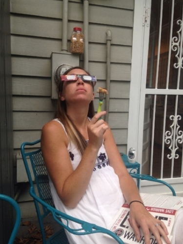 Here's a candid #glamourshot of me, watching the eclipse and eating chicken off of a baby fork. #electricmeter