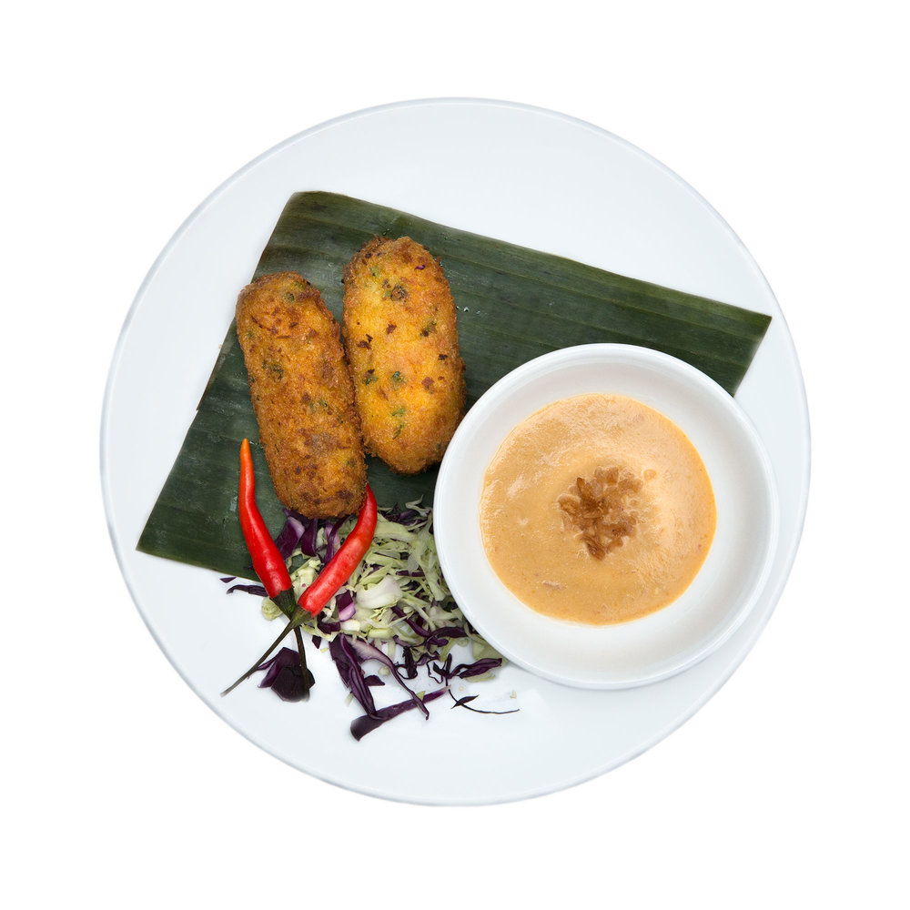 Perkedel $4.95 (V) - Oven-baked fritters (2 pieces) served with fresh pickle and peanut sauce