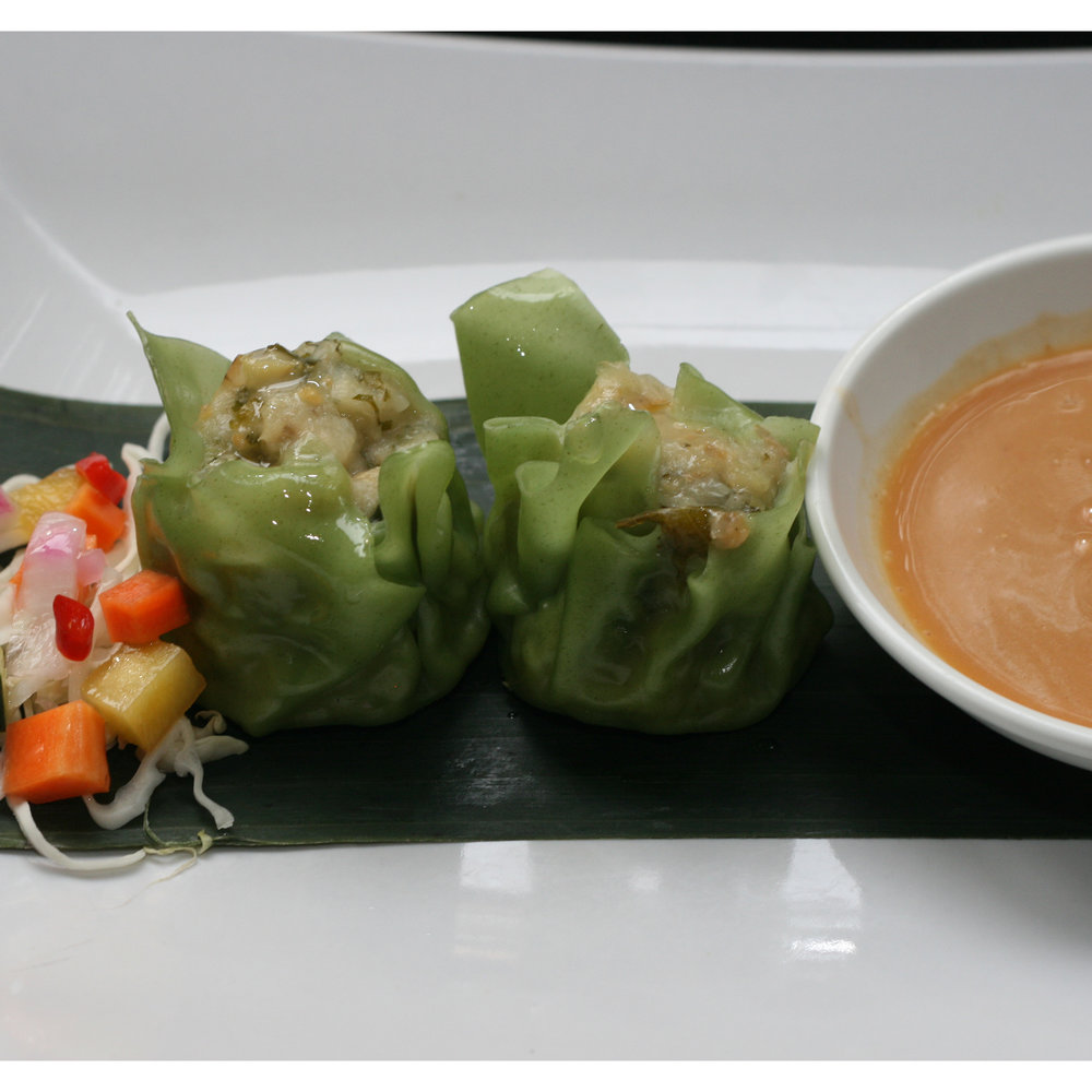 Siomay $5.95 (V) - Steamed dumplings (2) served with fresh pickle and peanut sauce