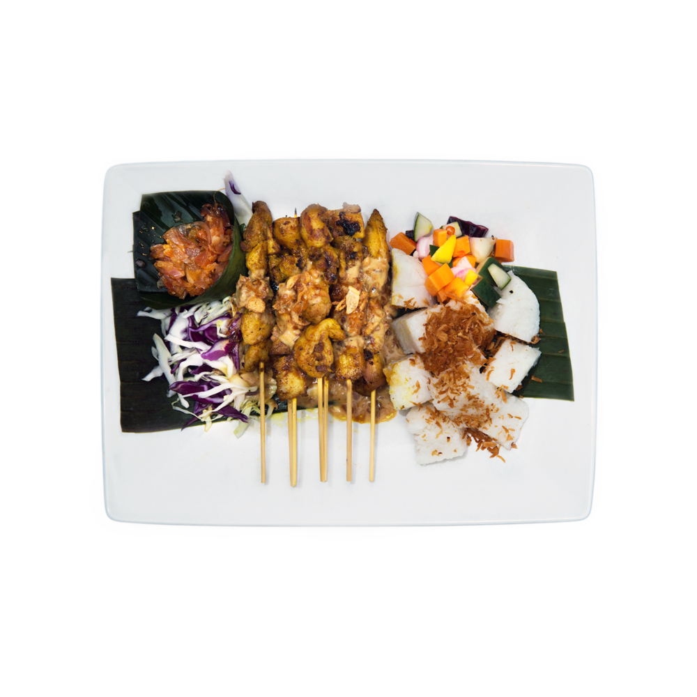 Sate Makassar $13.95 (V) - Chicken or mock chicken, coconut rice cake, salad with spicy mango relish and bilimbi peanut sauce