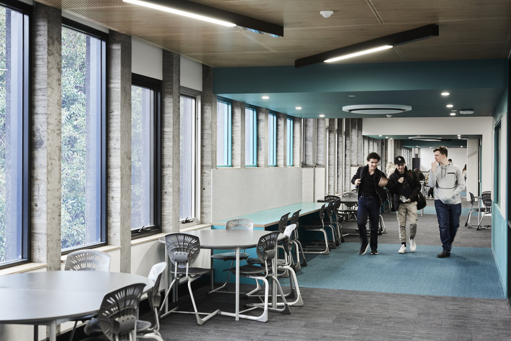 Y2 have transformed a 1960s building into a 21st century learning environment. The wing was essentially 110m of classrooms along a single side of a gun barrel corridor.Y2 have re-designed this as a meandering series of learning studios, with pockets of breakout spaces, studies and kitchenettes. They have used glass to create stronger visual connections into the studios, and out into the adjacent park and the city beyond.