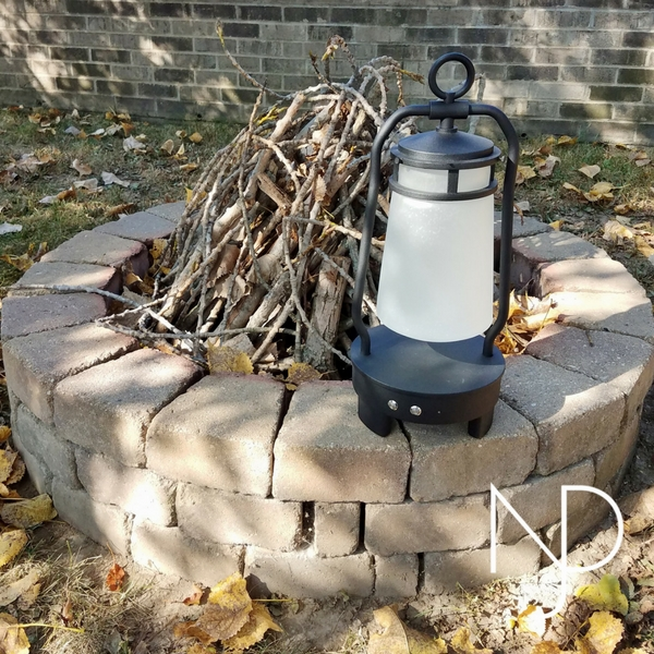 The Kichler Lyndon Portable Bluetooth LED Lantern Outside  by Fire