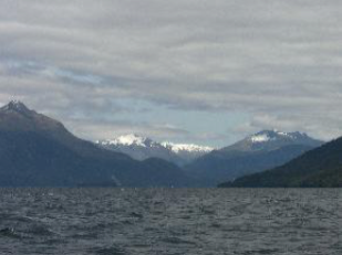 The Middle Fjord of Lake Te Anau, with a nice 10 knot breeze carrying a group of five trailer yachts round Rocky Point (on the right) towards North Fjord.