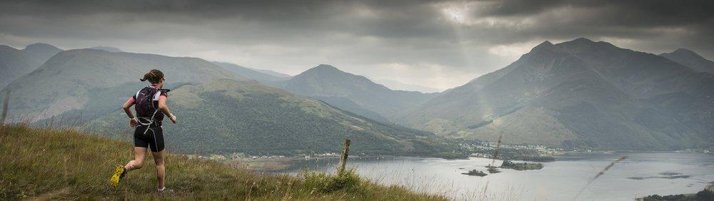 runner nears Loch Leven Scotland