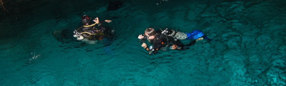 two divers descend into Dos Ojos cave, Yucatan