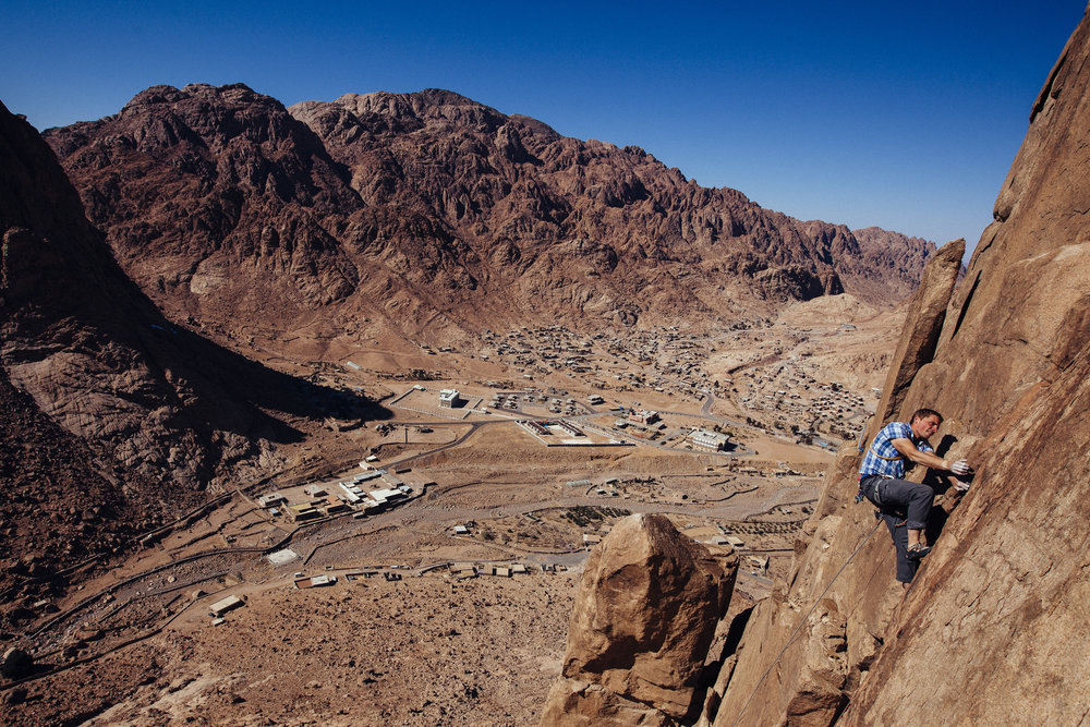 Dave Lucas climbing above St Katherine's village in the Sinai Desert, credit Ed Giles