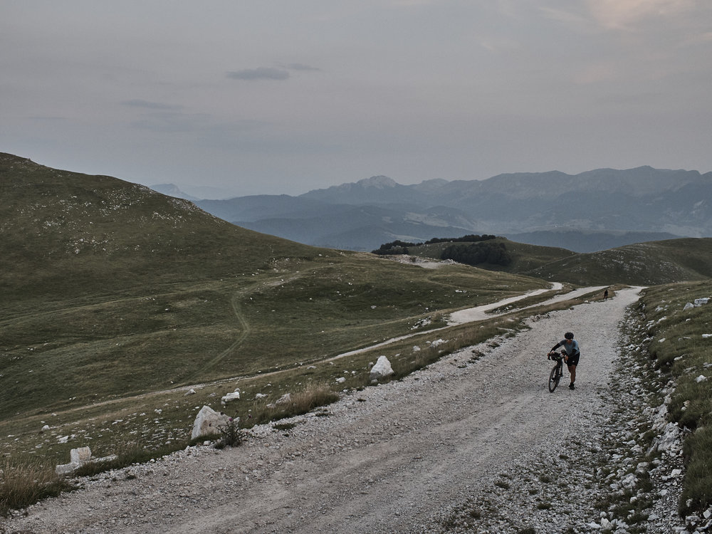 Bjorn on the long haul up to CP4 in Bjelašnica, Bosnia, Camille McMillan