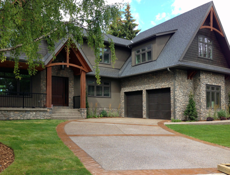 E20-calgary-custom-home-beautiful-stone-exterior-timber-trusses-750x570.jpg