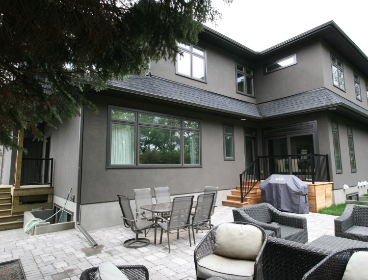 E23-luxury-home-stone-patio-patio-living-calgary-custom-home-750x570.jpg