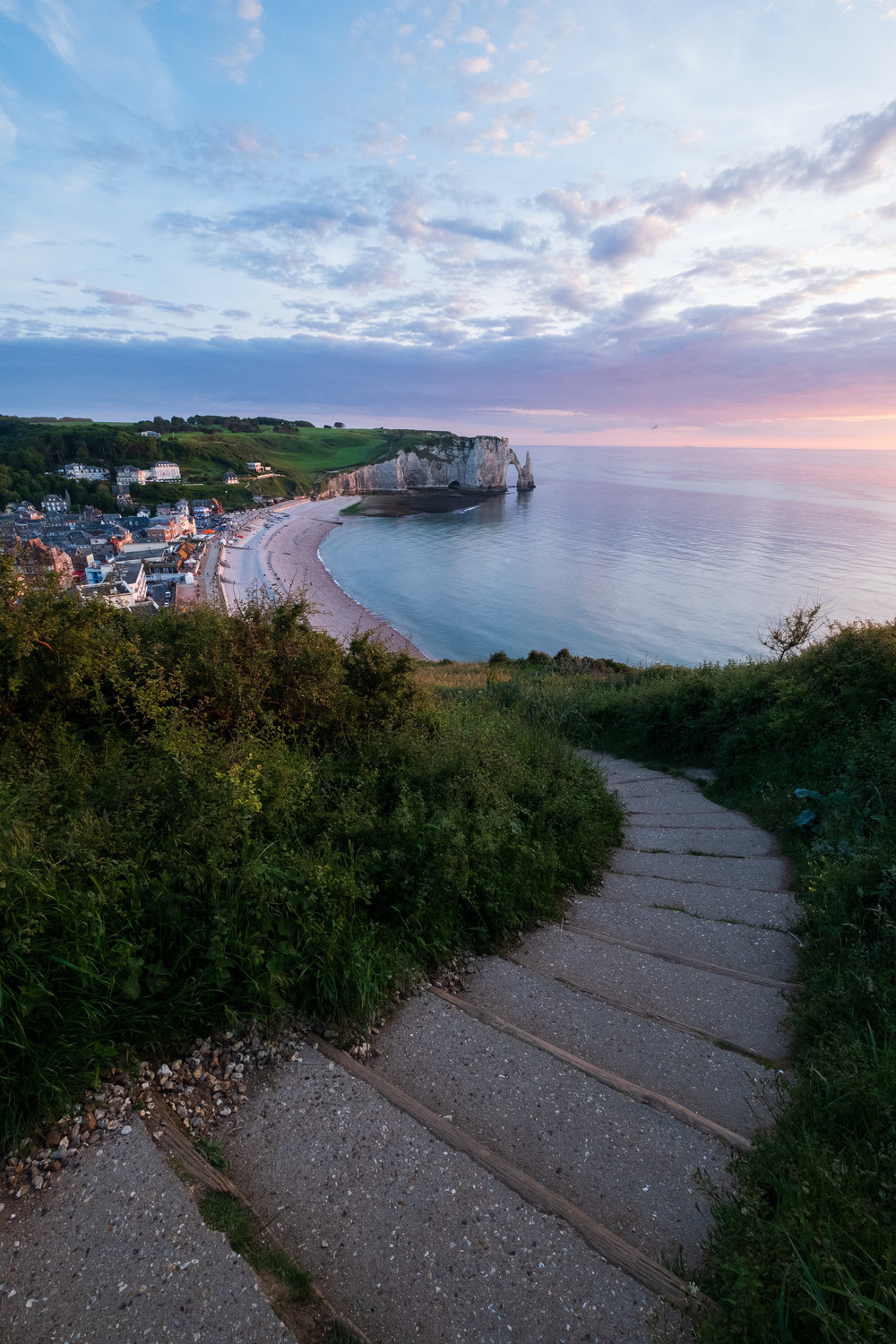 The stairs lead you to Étretat bathing in the golden light