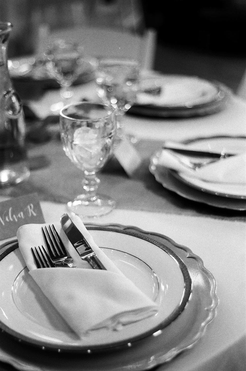 black and white 35mm film Photograph of Guestdinner table setup Details taken by Joseph Barber wedding photography newport beach