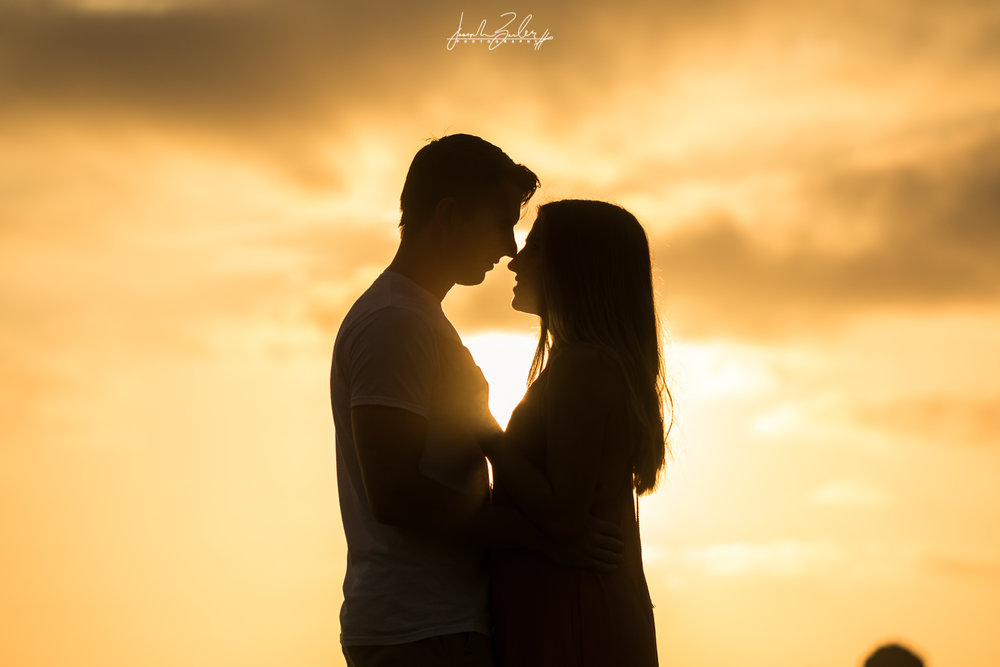 Silhouette of a couple embracing during Golden hour at Little Corona Beach for the engagement session
