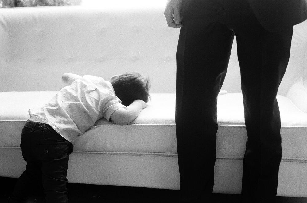 black and white 35mm film Photograph of Little boy sleeping during wedding taken by Joseph Barber wedding photography newport beach