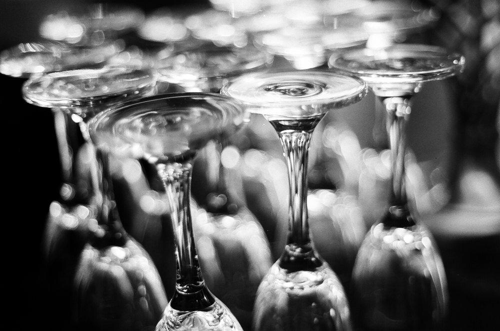 black and white 35mm film Macro Photograph of Polish Champagne glasses taken by Joseph Barber wedding photography newport beach