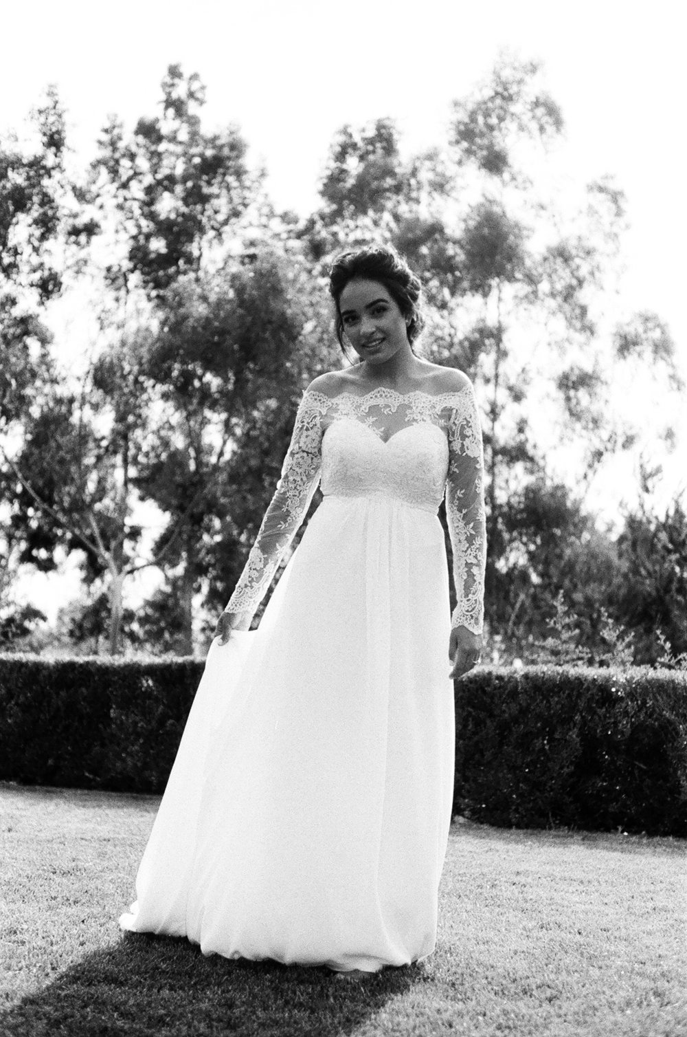 black and white 35mm film photograph of bride Posing in her wedding dress Before the ceremony taken by Joseph Barber wedding photography newport beach
