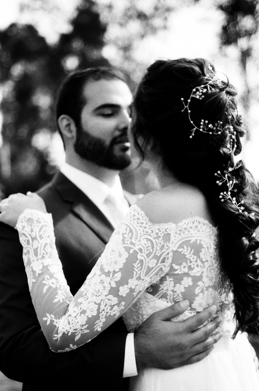 black and whitephotograph of bride and groom Embracing each other Before the ceremony taken by Joseph Barber wedding photography newport beach