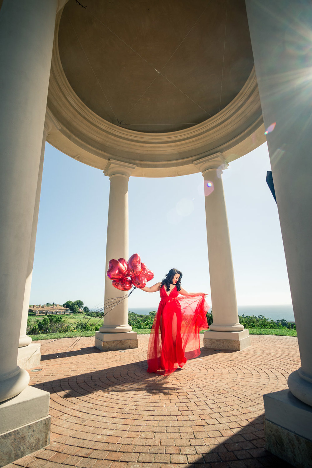 Pelican Hill Resort rotunda photoshoot with Kim Thai and fashion nova red dress