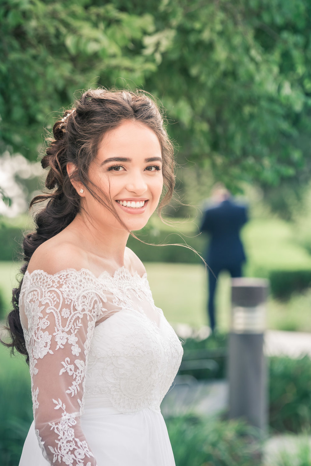 Portrait of a bride posing in her wedding dress Beautiful hair For her first book in Brea California