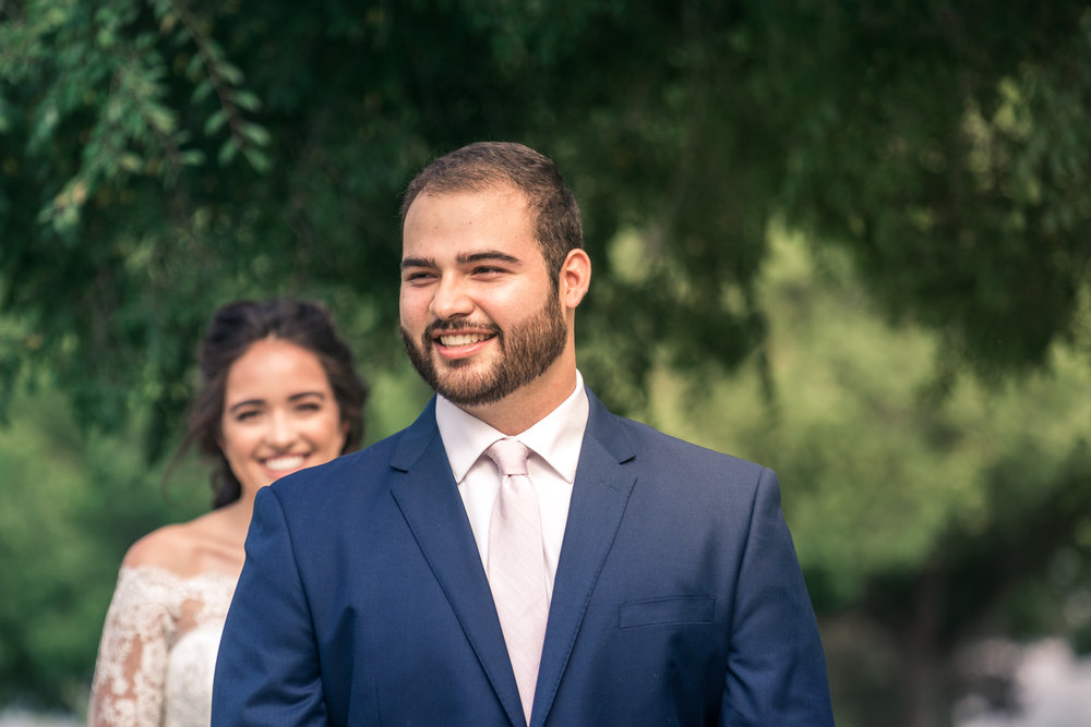 Portrait of groom waiting and  Anticipating His bride On their wedding day for the first look in Brea California