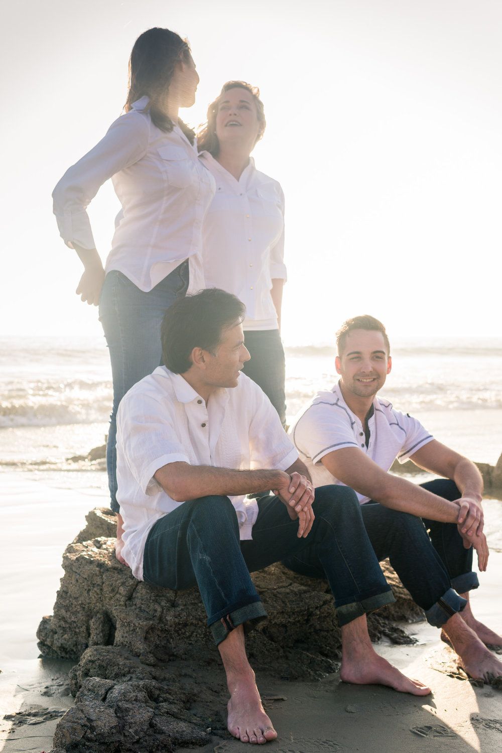 Family portraits being backlit during Golden hour at Crystal Cove State Beach in Newport