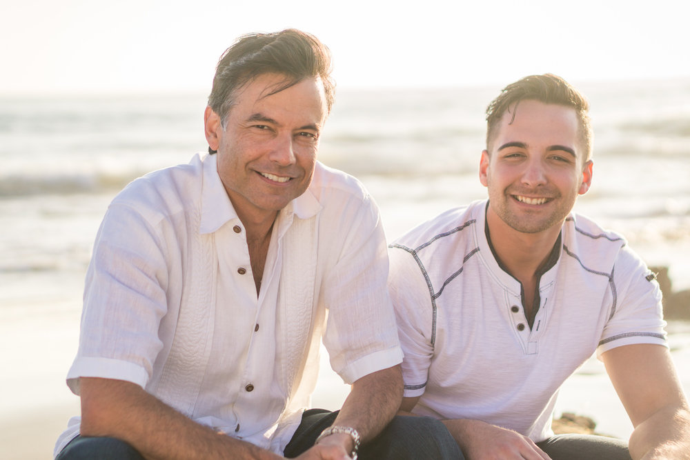 Family portraits  Of Father and son being backlit during Golden hour at Crystal Cove State Beach in Newport