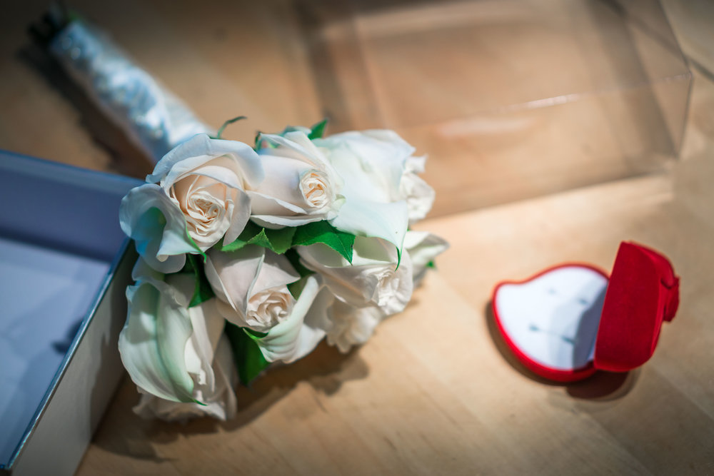 Brides bouquet and wedding ring On a table before the wedding ceremony