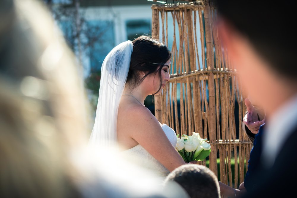 The bride at the altar at Her Balboa Island wedding