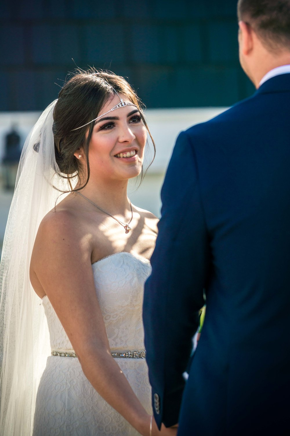 The bride and groom looking at each other in love at the altar during their wedding ceremony in Balboa Island