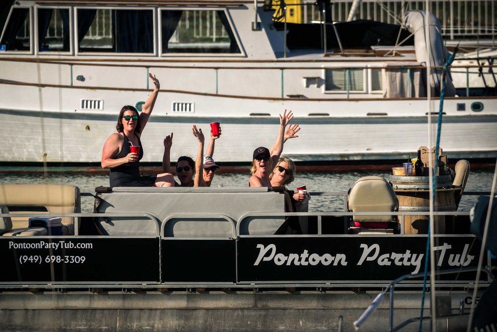 Passerbys on a boat waving and cheering on for the wedding