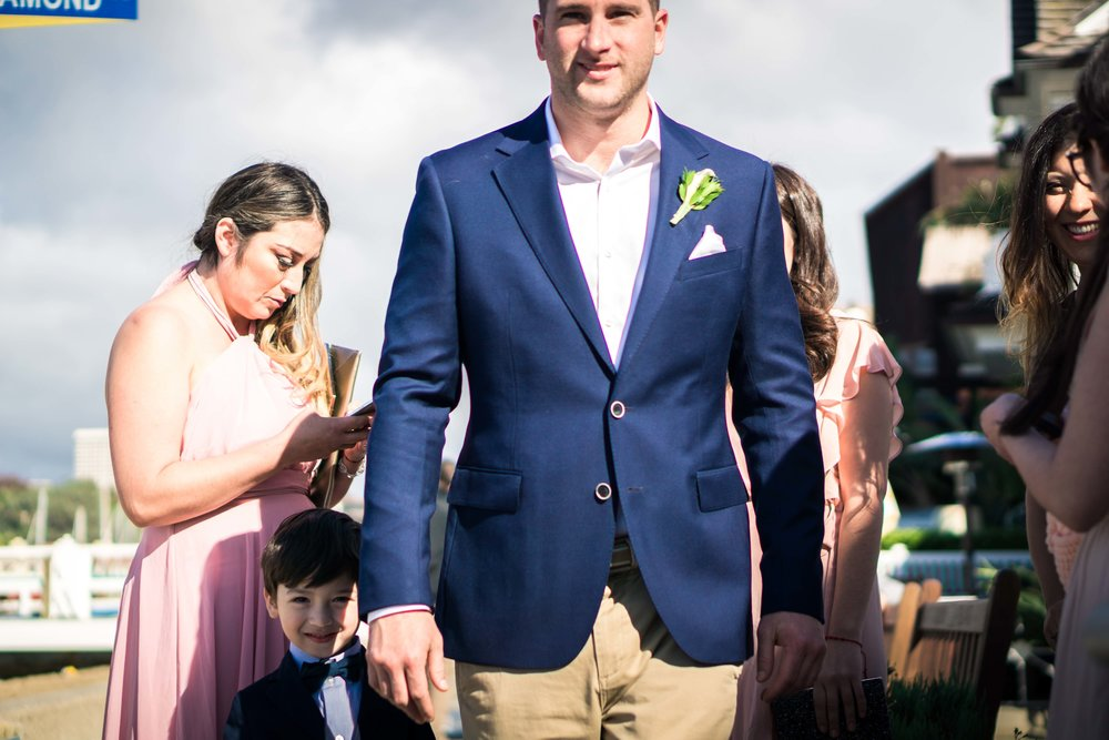 The groom and the ring bearer standing next to each other for portrait