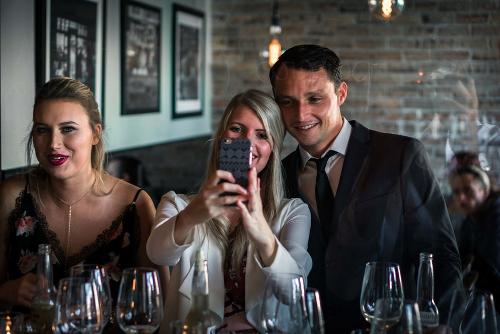 Wedding guest smiling and taking selfies at the Royal hen restaurant