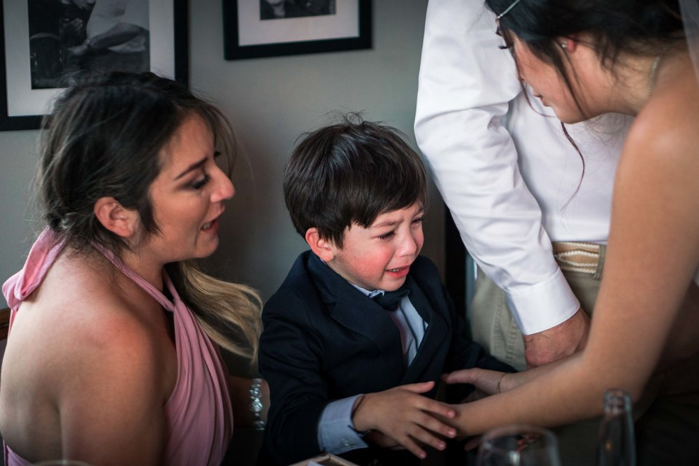 The ring bearer crying at the wedding reception