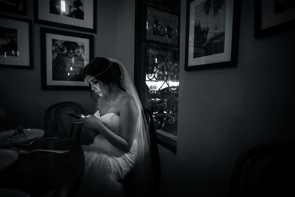 The bride sitting alone during the wedding reception