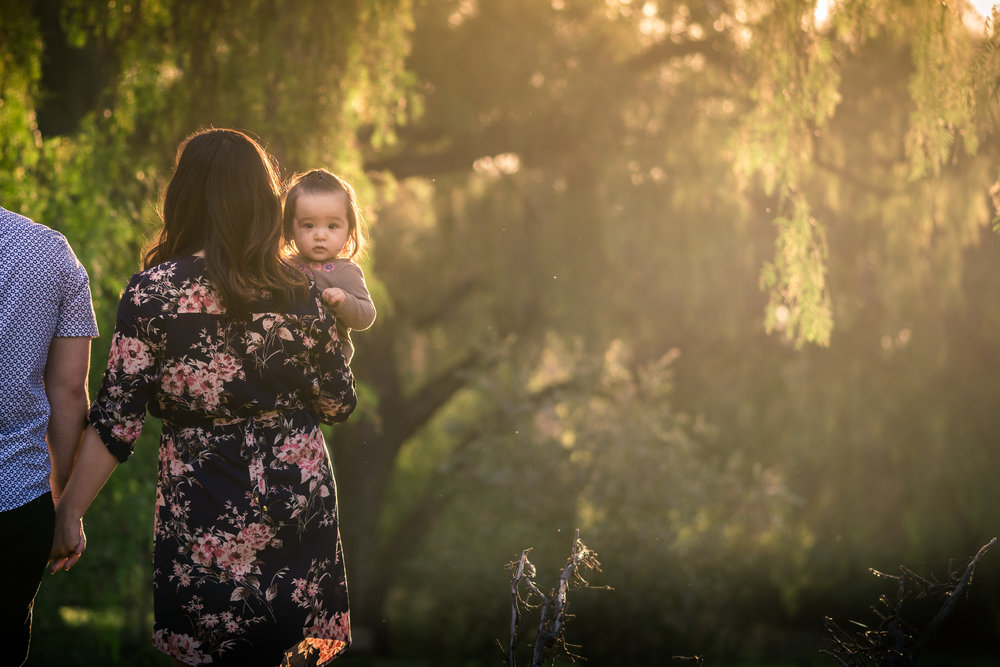Candid family portrait of little girl looking back During a Photo shoot Taken by Joseph Barber photography