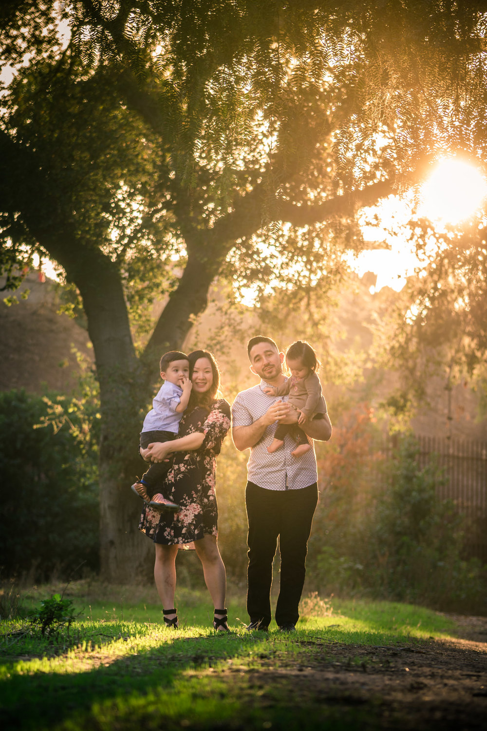 Candid family portrait of a family walking on the one Juanita Cooke trail in Fullerton during golden hour Taken by Joseph Barber photography