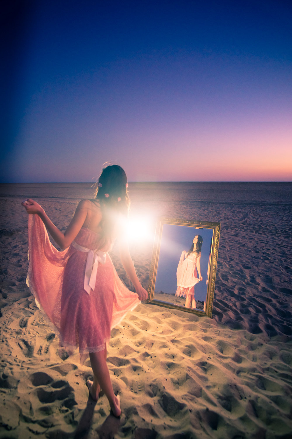 Portrait of a Lady in mirror wearing a pink dress at sunset  on Balboa Island in Newport Beach California By Joseph Barber photography