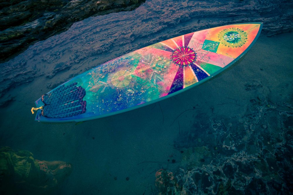photo of custom hand painted surfboard at little corona beach tidepools
