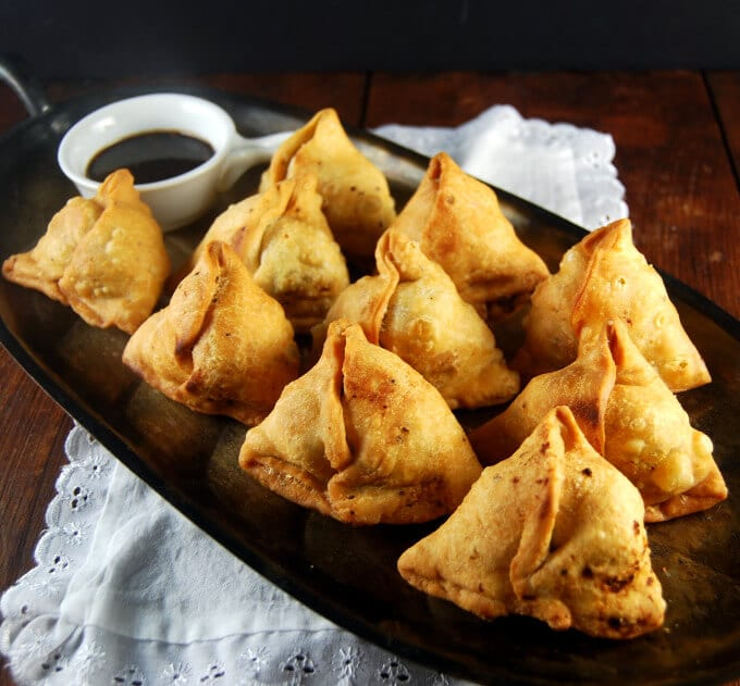 PUNJABI SAMOSAS    There's something about samosas that just screams 'Christmas Day' to us! This recipe for 100% vegan samosas is about as indulgent as it gets! If all goes well, you'll end up eating the whole tray at once!
