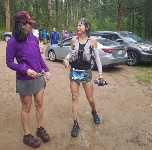 With Kari Anne Gibbons (not the woman in the story!) a few miles before the hip injury at muddy Black Hills 100.