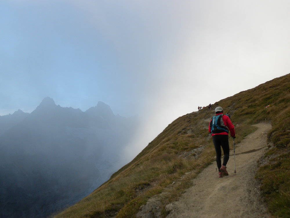 Runner at UTMB climbs steep hill in Italy