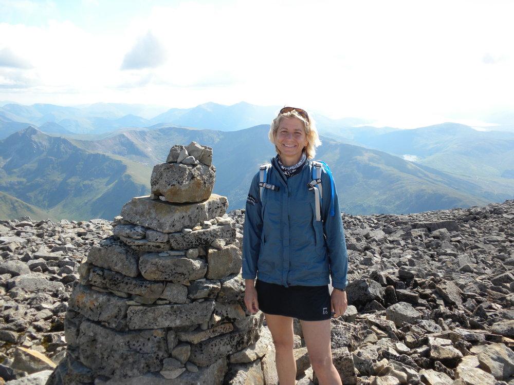 Susan Donnelly on run at Ben Nevis peak cairn