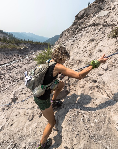 Susan Donnelly climbing a cliff at Bigfoot 200.