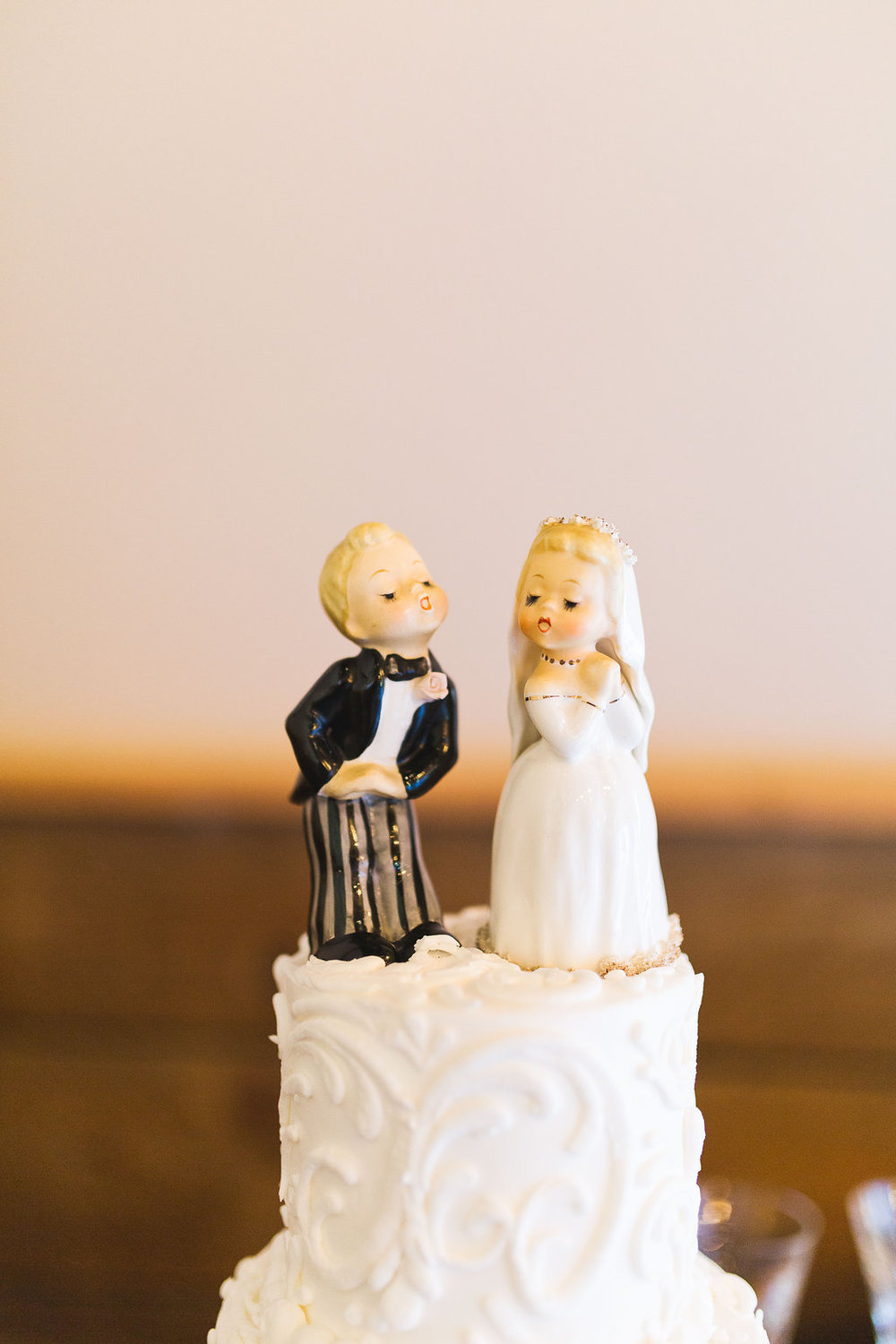 This was one of my favorite details from the wedding.  These porcelain cake toppers were used on her grandmother's wedding cake.  How adorable??!