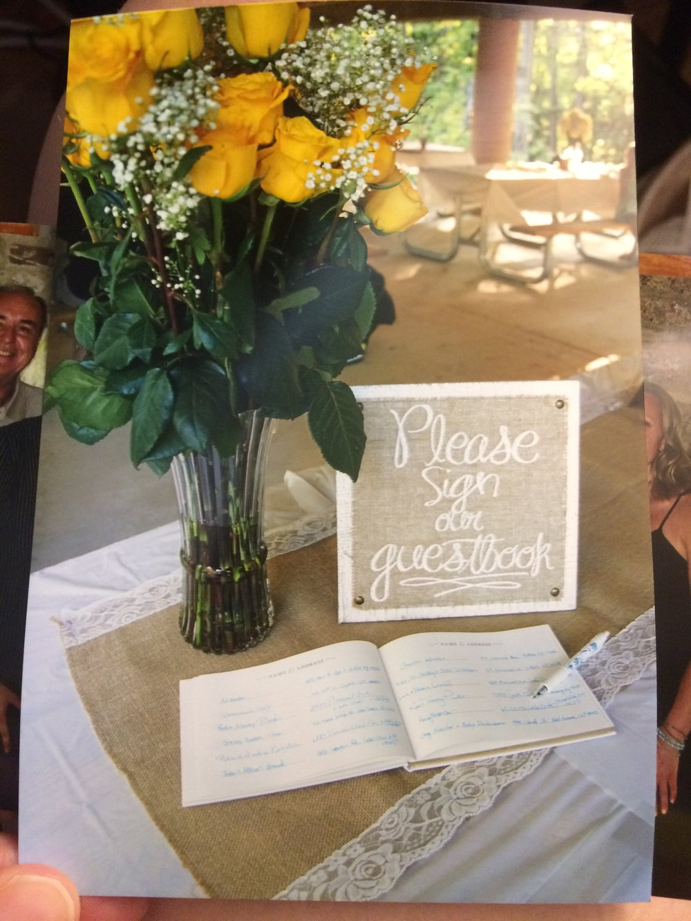 Our sign in book and yellow flowers picked out by my new niece.