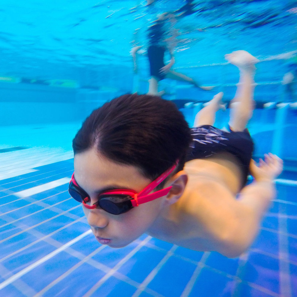 Boy swimming under water.