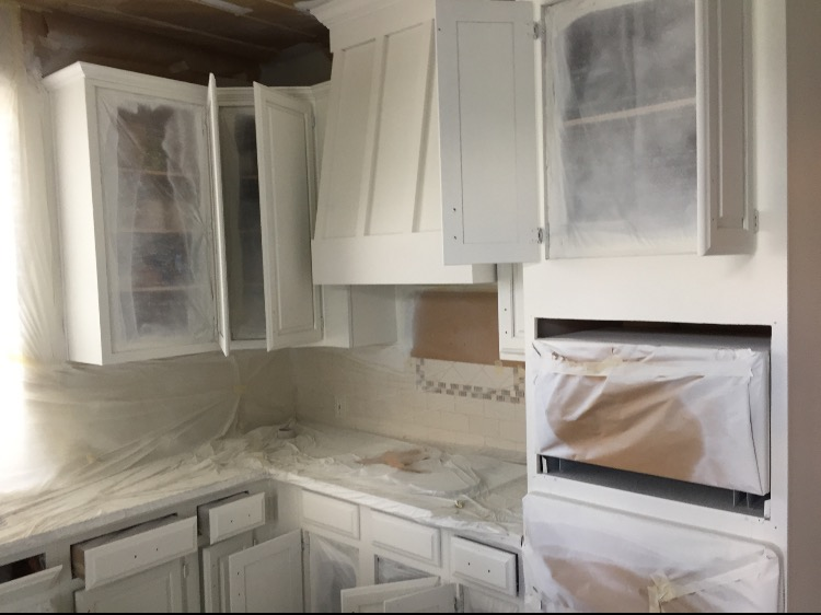 Sherwin Williams alabaster cabinets in this kitchen makeover by Julie Warnock interiors