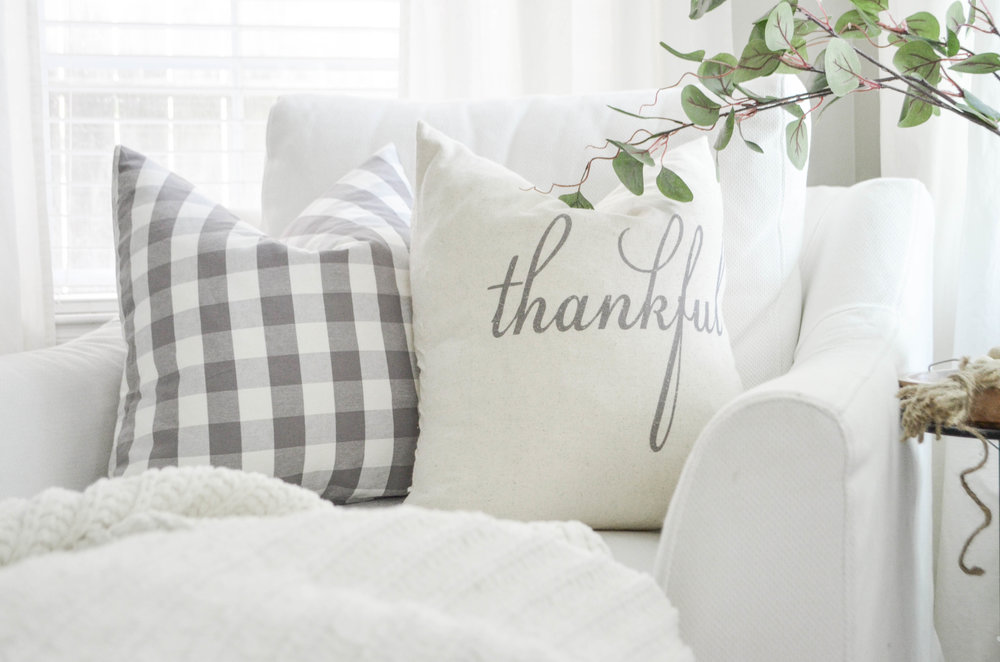 """Thankful"" pillow by Porterlane Home and styled by Julie Warnock Interiors."