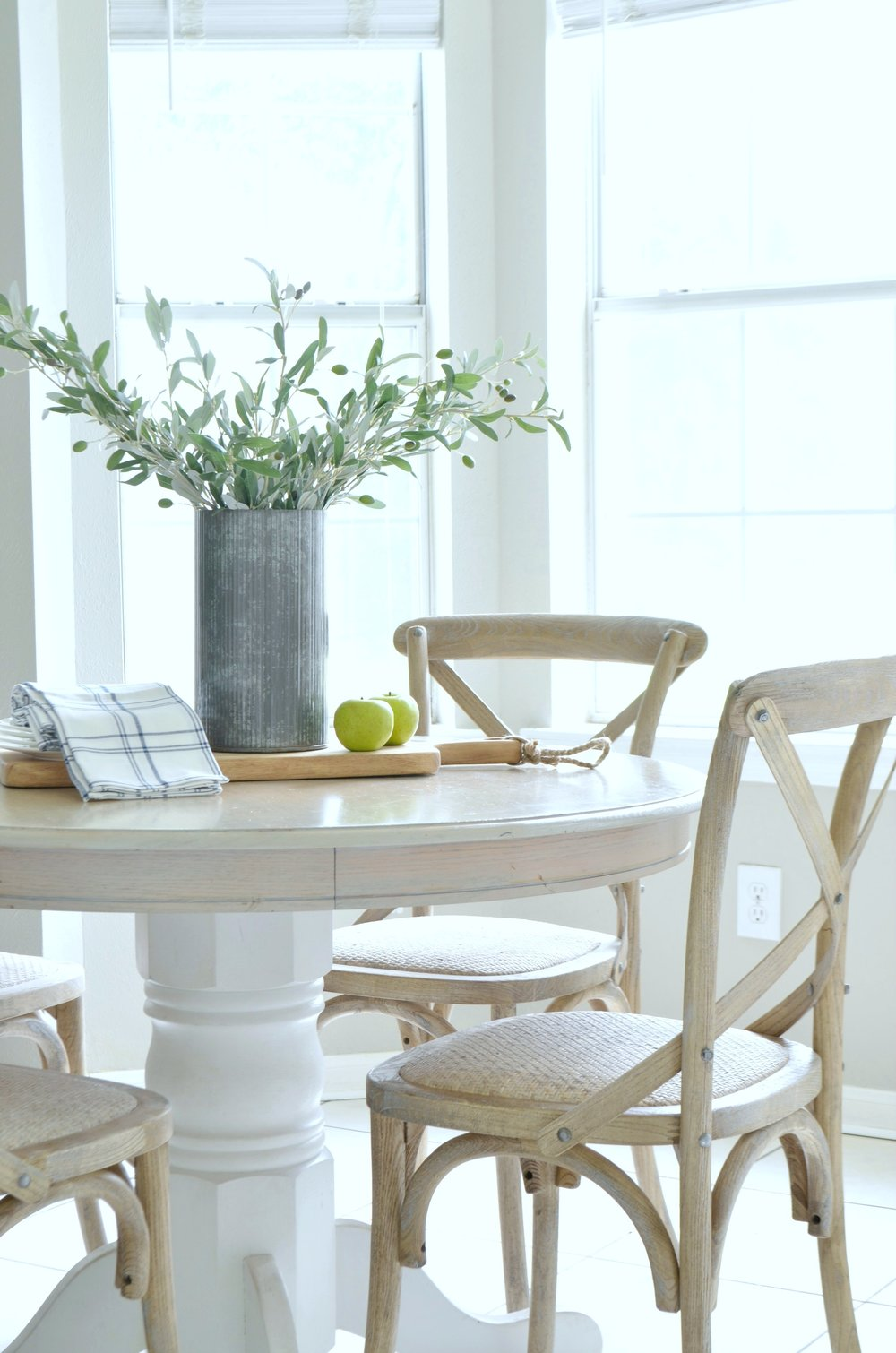Farmhouse-style dining chairs give the breakfast nook an instant facelift.
