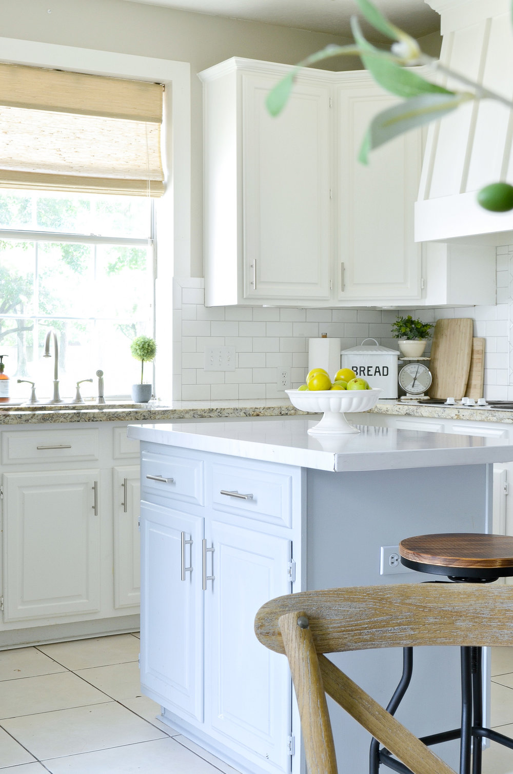 Adding farmhouse charm to the kitchen with woven shades.
