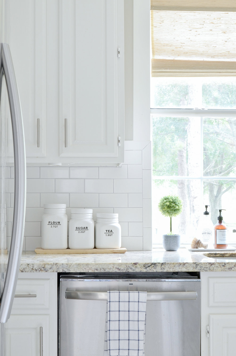 Adding farmhouse charm in the kitchen with woven shades.